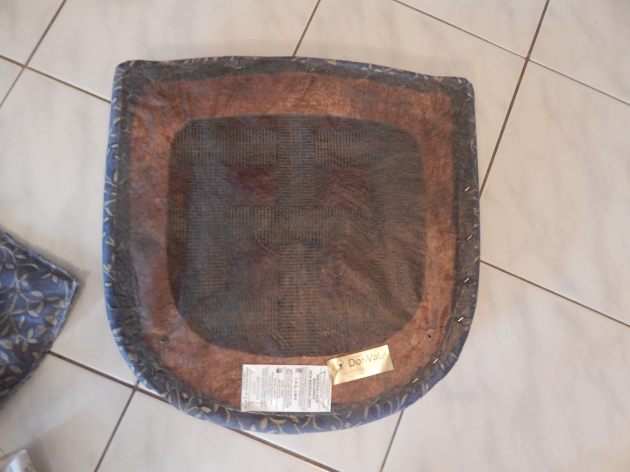 Remove dust cover from seat pad.