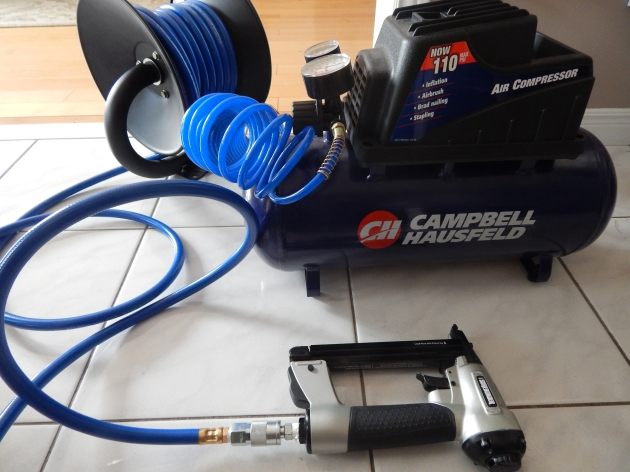 Air compressor with stapler attachment.